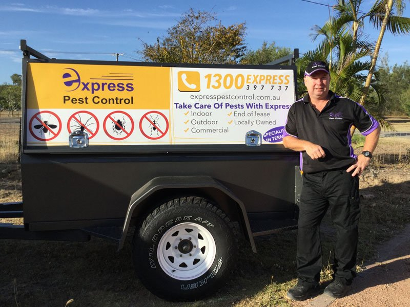 standing next to pest control trailer